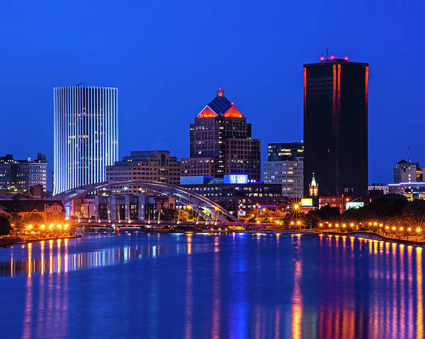 Photograph - The Rochester Skyline Reflecting The The Genesee River Rochester Ny Blue Building by Toby McGuire