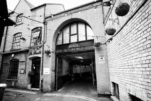 Wall Art - Photograph - The Royal Irish Automobile Club Car Park Entrance And La Ruelle Wine Bar Dublin Republic Of Ireland  by Joe Fox