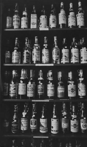 Puerto Rican Photograph - The Rum Pilot Plant Storage Cabinet Wher by Gordon Parks