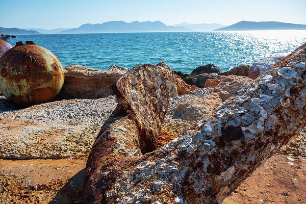 Photograph - The Rusty Anchor At Aegina Port by Iordanis Pallikaras