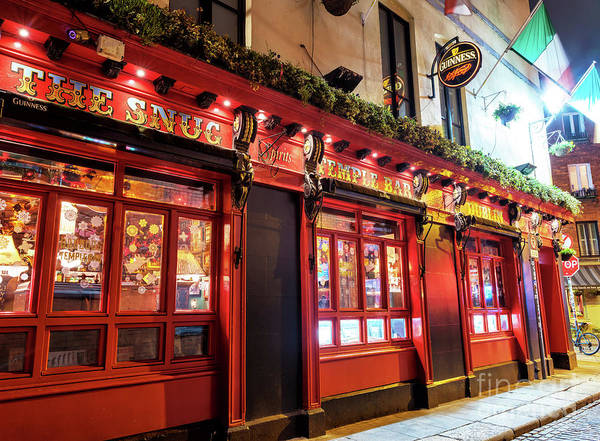 Wall Art - Photograph - The Snug Temple Bar At Night In Dublin by John Rizzuto