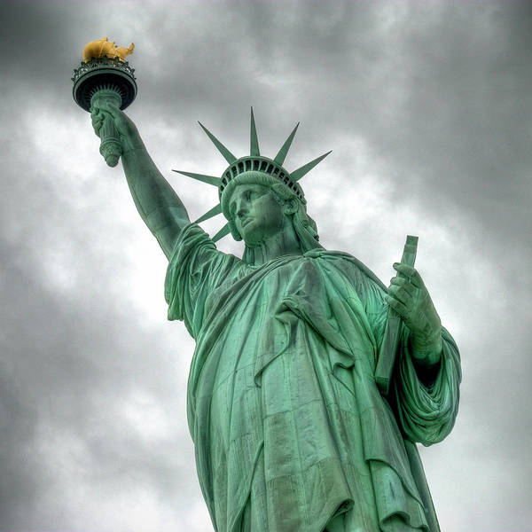 Statue Photograph - The Statue Of Liberty Nyc Under A by Marcel Germain