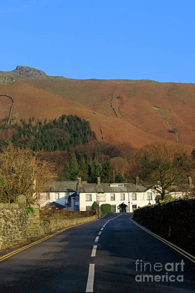 Wall Art - Photograph - The Swan Inn And Rydal Fell From Grasmere Village Lake District by Louise Heusinkveld