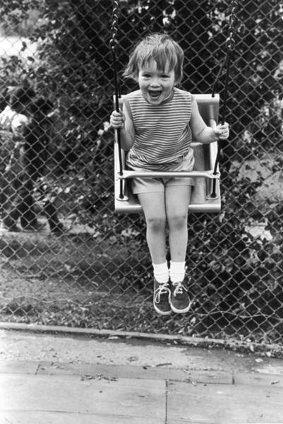 Playful Photograph - The Swinger by Anna Kaufman Moon