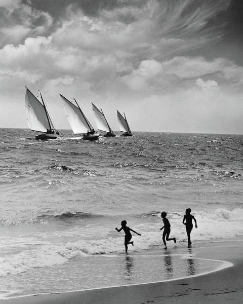 The Past Photograph - Three Boys Running Along Beach by Stockbyte