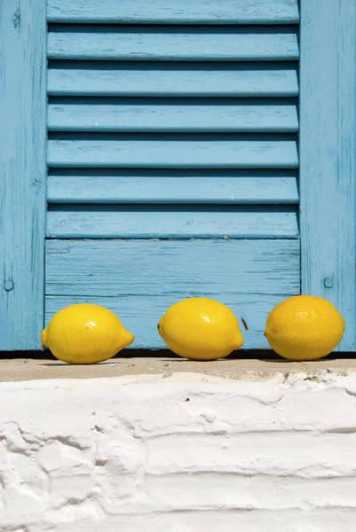 Lemon Photograph - Three Lemons In A Window by Frankvandenbergh