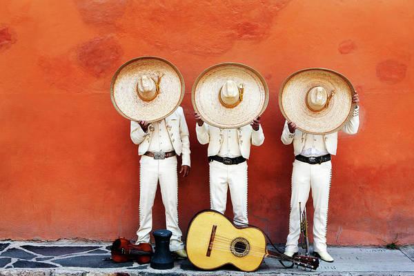 Sun Hat Photograph - Three Mariachis On An Orange Wall by Holly Wilmeth