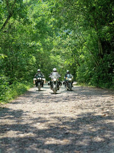 Crash Helmet Photograph - Three Men Riding Motorbikes Along by Xpacifica