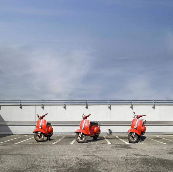 Parking Garage Photograph - Three Red Motor Scooters At Parking Deck by T. Fuchs