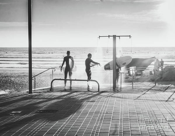 Photograph - Three Surfers Rinsing Off In A Beach Shower After Surfing by PorqueNo Studios