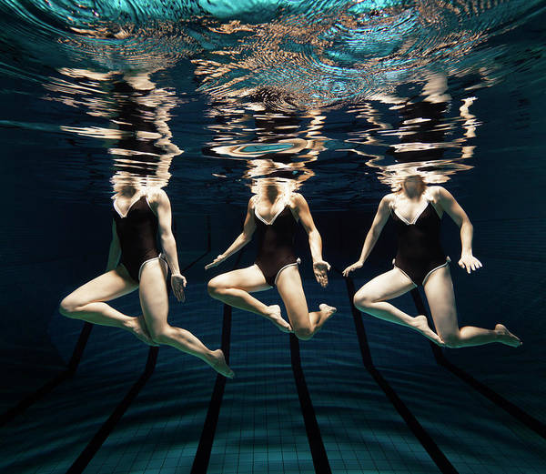 One Piece Swimsuit Photograph - Three Synchronised Swimmers In Line by Henrik Sorensen