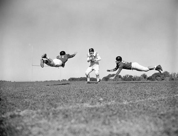 Football Helmet Photograph - Three Teenage Boys Playing American by H. Armstrong Roberts