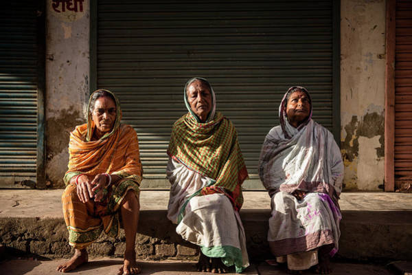 Wall Art - Photograph - Three Women Sitting By The Sidewalk Of A Street In Vrindavan by Ruben Vicente