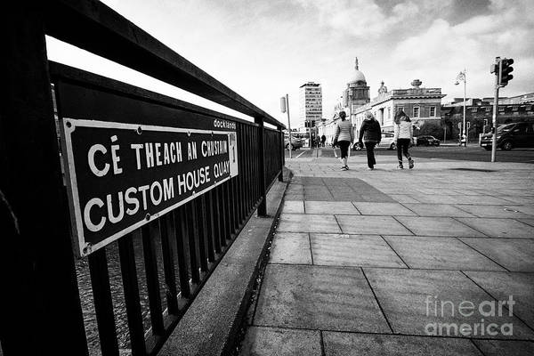 Wall Art - Photograph - three women walking along custom house quay with a view of the custom house docklands Dublin republi by Joe Fox