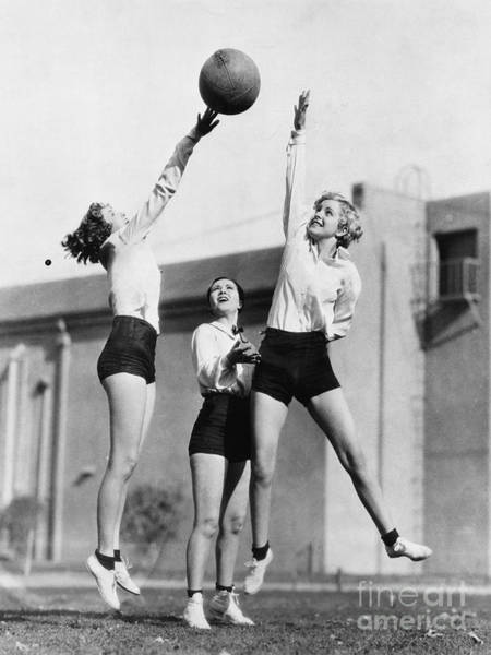 Wall Art - Photograph - Three Women With Basketball In The Air by Everett Collection