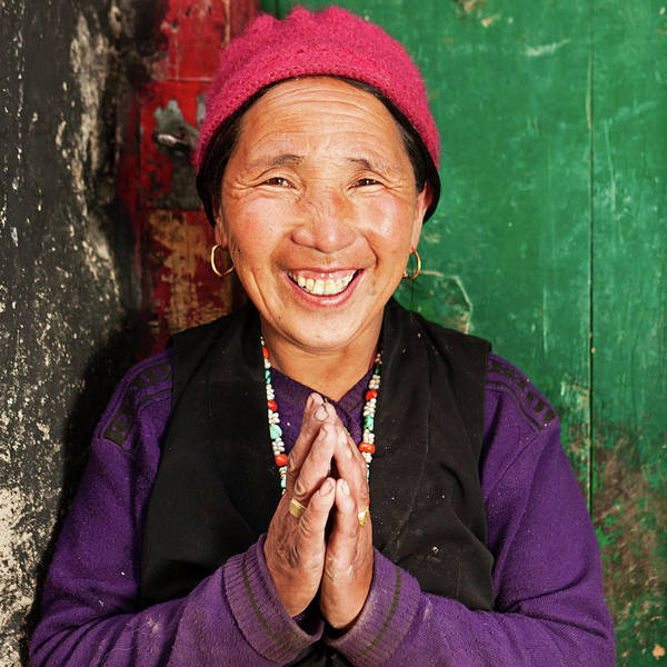 Wall Art - Photograph - Tibetan Woman Praying by Hadynyah