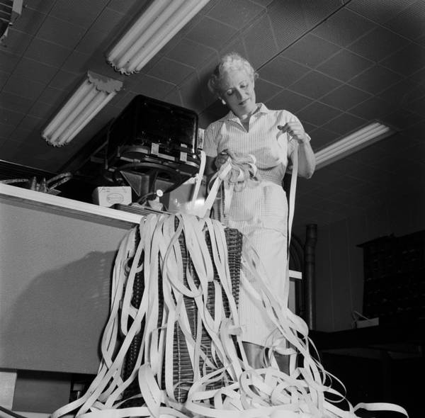 Businesswoman Photograph - Ticker Tape by Evans