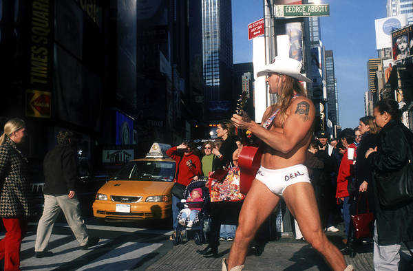 Street Performers Photograph - Times Sq, Nyc, The Naked Cowboy by Rudi Von Briel