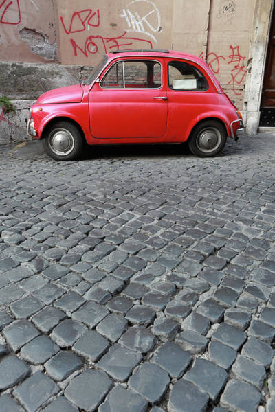 Sparse Photograph - Tiny Red Vintage Car In Rome, Italy by Romaoslo