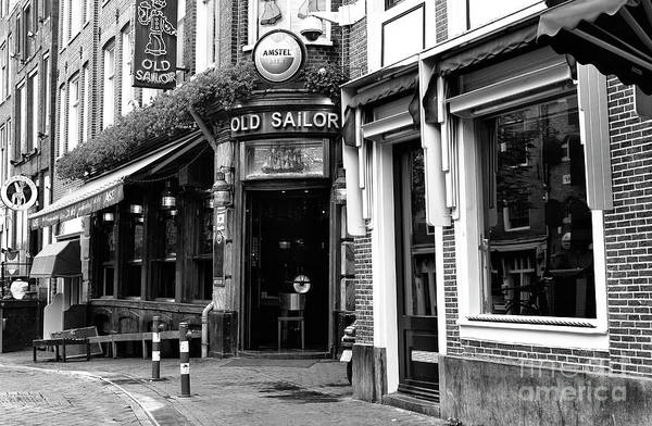 Wall Art - Photograph - To The Old Sailor In Amsterdam by John Rizzuto