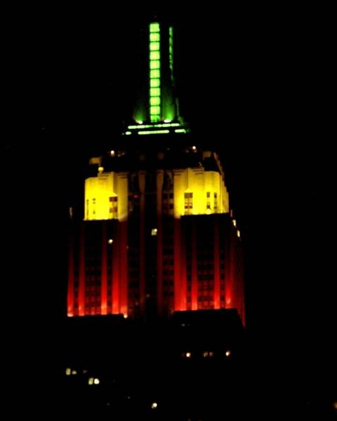 Yellow Photograph - Top Of Empire State Building At Night by New York Daily News Archive