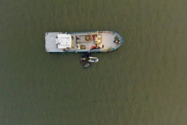 Fishing Boat Photograph - Top View Cockles Fishing Boat At Wadden by Roelof Bos