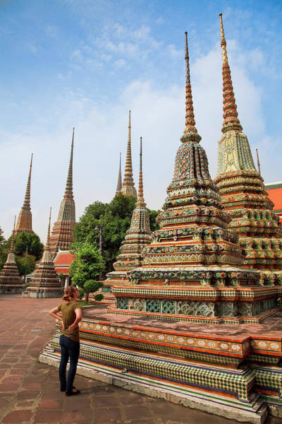 Learning Photograph - Tourist Viewing Chedi At Buddhist Temple by Blake Kent / Design Pics