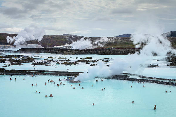 Geothermal Photograph - Tourists Bathe In The Blue Lagoon by Ed Norton