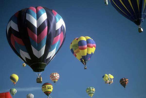 Photograph - Tourists Ride Hot Air Balloons During A Mass Ascension by Steve Estvanik