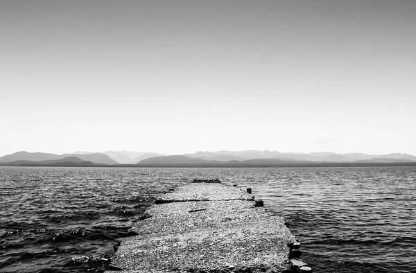 Photograph - Old Stone Docks On The Nahuel Huapi Lake In The Argentine Patagonia - Black And White by Fine Art Photography Prints By Eduardo Accorinti