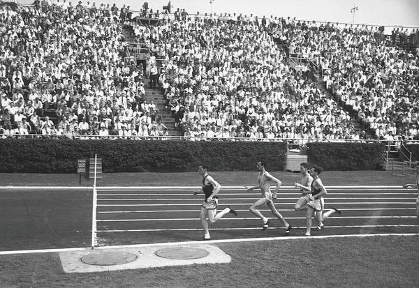 Spectator Photograph - Track Athletes Running On Track, B&w by George Marks