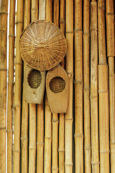 Wall Art - Photograph - Traditional Chinese Woven Hat On Bamboo by Adam Jones