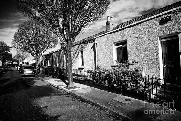 Wall Art - Photograph - traditional Dublin stone old houses on foster terrace normally starter homes in ballybough dublinRep by Joe Fox