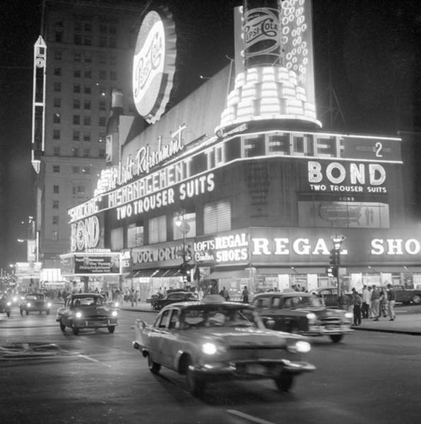 Photograph - Traffic And Stores In Times Square by Bettmann