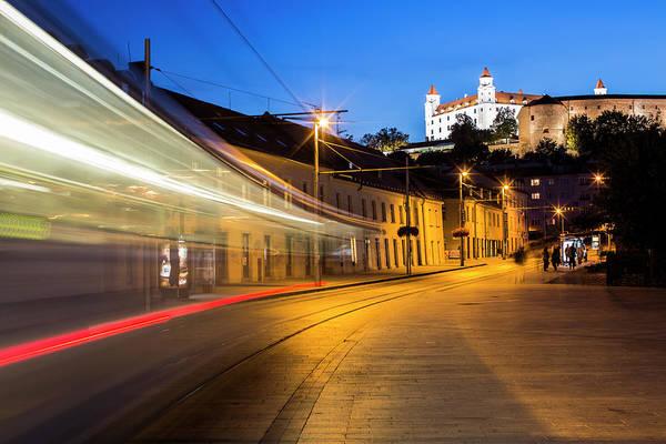 Bratislava Photograph - Tram In Motion At Dusk, Bratislava by Tim E White