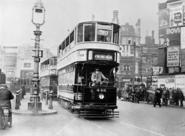 Public Land Photograph - Tram In Street by Kirby
