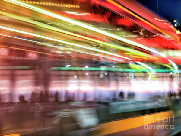 Wall Art - Photograph - Tram Motion At Night In Dublin by John Rizzuto