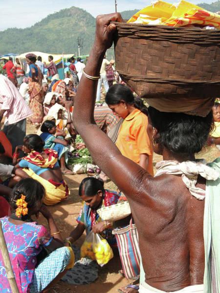 Photograph - Tribal Women Carry Goods  On Their Heads by Steve Estvanik