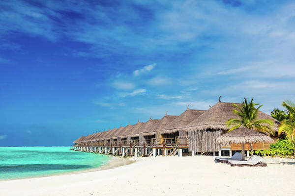 Photograph - Tropical Beach With Straw Cabins On Maldives. by Michal Bednarek