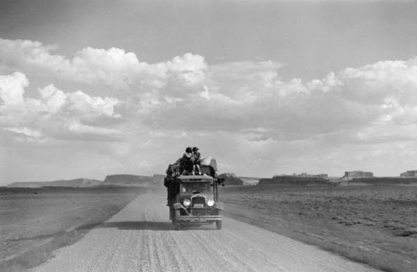 Driving Photograph - Truck Driving Down Dirt Road.  Photo By by Peter Stackpole