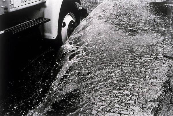 Danger Photograph - Truck Driving Through A Puddle by Henri Silberman