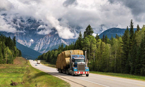 Wall Art - Photograph - Truck Loaded With Straw Bales On The Yellowhead Highway Behind It Mount Robson Partly Covered By by imageBROKER - Marco Bittel