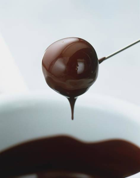 Fondue Photograph - Truffle On Metal Skewer Dipped In by Ian O'leary