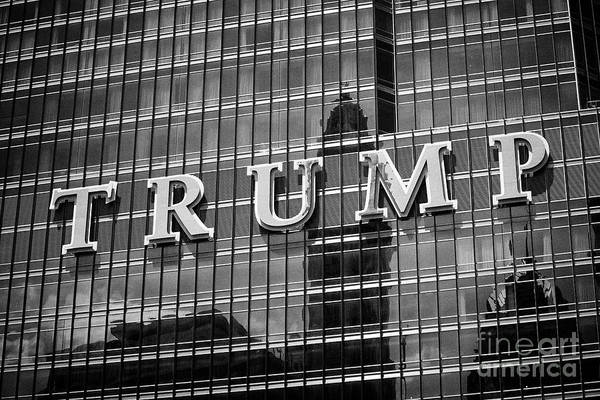 Wall Art - Photograph - Trump Name In Large Letters On The Side Of The Trump International Hotel And Tower Chicago Il Usa by Joe Fox