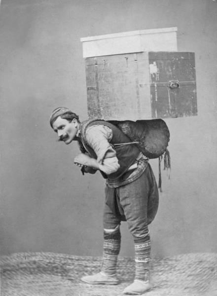 Porter Photograph - Trunk Bearer by P L Sperr