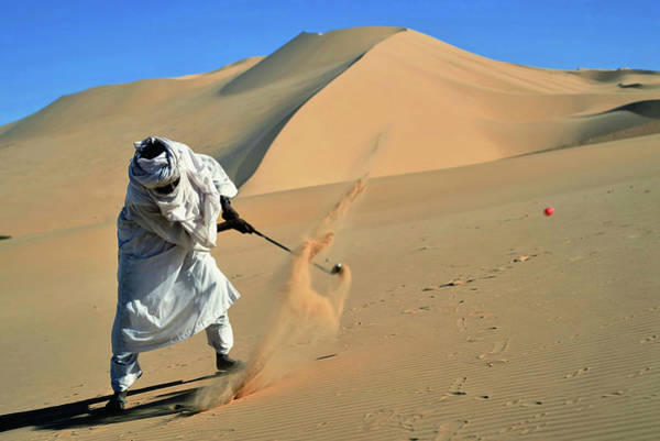 Headwear Photograph - Tuareg Playing Golf In The Sahara Dunes by Friedrich Schmidt