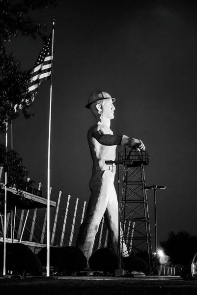 Photograph - Tulsa Golden Driller And Usa Flag - Monochrome by Gregory Ballos