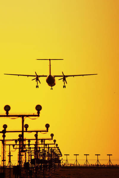 Arrival Photograph - Turboprop Commercial Airplane Landing by Brian Stablyk