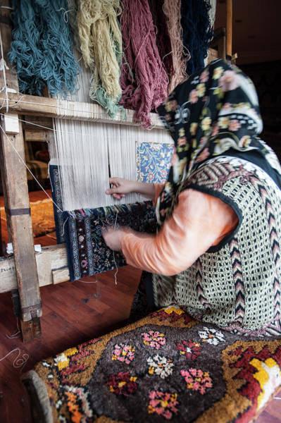 Wall Art - Photograph - Turkish Woman Carpet Weaving by Steve Outram