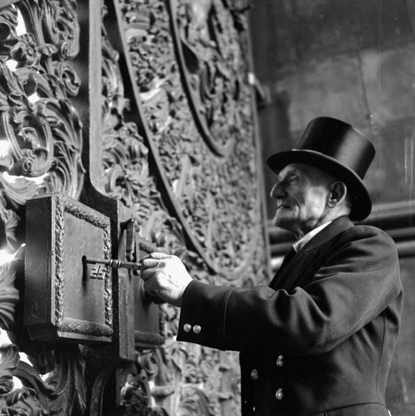 Top Hat Photograph - Turning The Key by Charles Hewitt